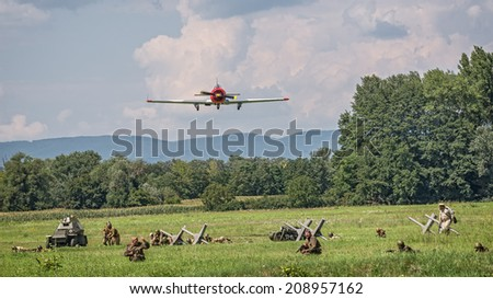 TEKOV, SLOVAKIA - JULY 26,2014:  Russian Yak bomber approaching the battlefield during reconstruction of a World War II fight between Red army and German army. - stock photo