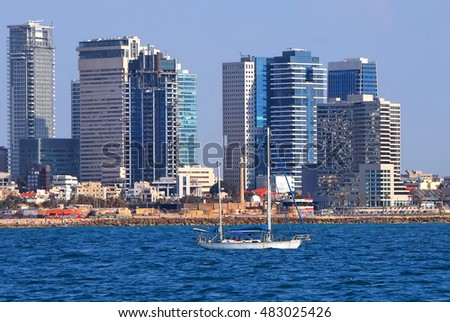 Tel Aviv coast  (seafront) view with sailboat in the waters. Mediterranean, Middle East, Israel