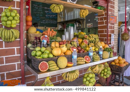 TEL AVIV, ISRAEL - APRIL 30, 2015: Shop selling fruit and juices, on a main city street