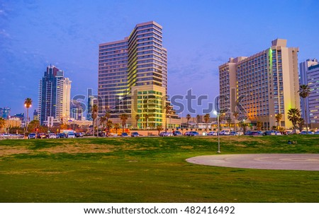 TEL AVIV, ISRAEL - FEBRUARY 25, 2016: The green meadow of Charles Clore Park with the modern hotels on the background, on February 25 in  Tel Aviv.