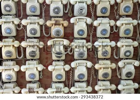 TEL AVIV, ISRAEL -  MAY 19, 2014: Installation of old phones in the Museum Tower, Tel  Aviv - stock photo
