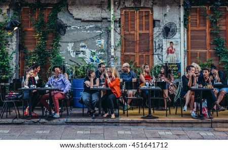 Tel Aviv, Israel - October 20, 2015. People sits at tables outside the restaurant at Rothschild Boulevard in Tel Aviv