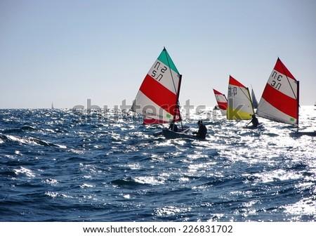 Tel Aviv, March 16, 2014. Children learn to sail on Optimist Sailboat. Tel Aviv, Israel - stock photo