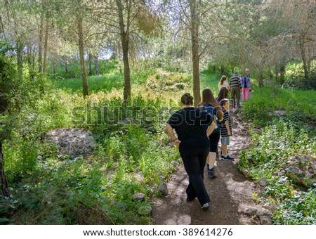 TEL AVIV - MARCH 6, 2016: Families hiking in a middle -eastern pine forest in Israel  in the Sharon area near Tel Aviv