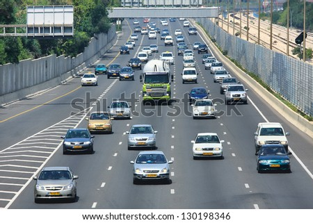 TEL AVIV - MAY 07: Traffic flow on highway during rush hour on sunny hot day. Highway 20 aka Ayalon is multi-lane highway and major intracity freeway in Tel Aviv, Israel on May 07, 2010. - stock photo