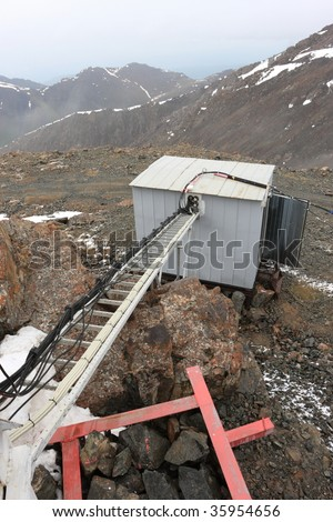 Telecom site in a mountains in winter - stock photo