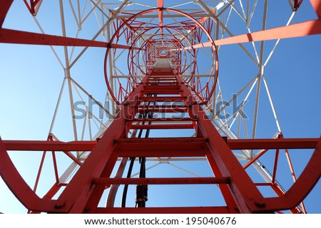 Telecom tower in the afternoon bright sunlight and cloudy blue  - stock photo