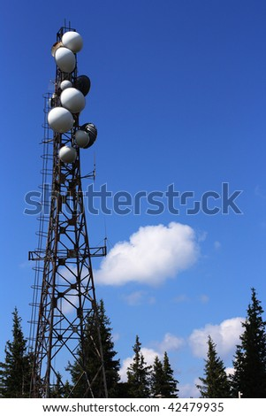 Telecom tower - mast with various antennae. GSM telecommunications. - stock photo