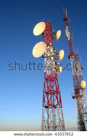Telecommunication Antenna on Background of Blue Sky. - stock photo