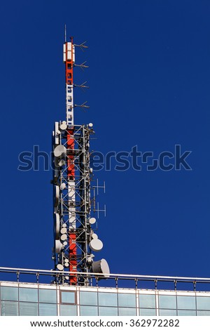 telecommunication antenna on top of modern building