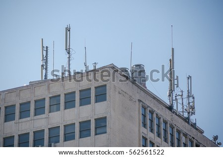 Telecommunication Antennas On The Roof Of The Building.