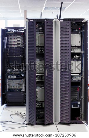 Telecommunication equipment  in a big datacenter.Cabinets