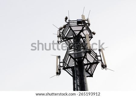 telecommunication equipment on top of antenna tower - stock photo