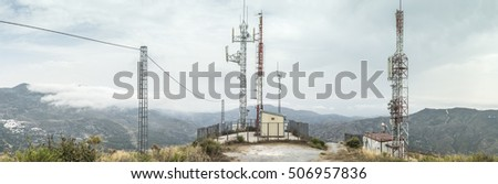 Telecommunication (GSM) towers with TV antennas on the mountain