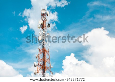 Telecommunication mast television antennas on blue sky and cloud - stock photo
