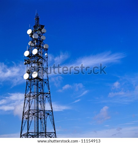 Telecommunication mast with blue sky background - stock photo