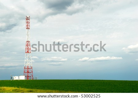 Telecommunication pillar in open field - stock photo