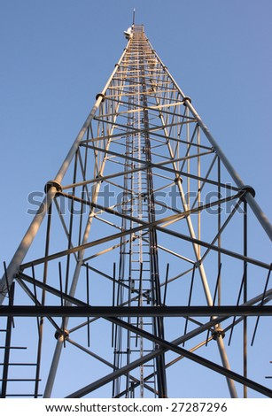 Telecommunication tower against a blue sky - stock photo