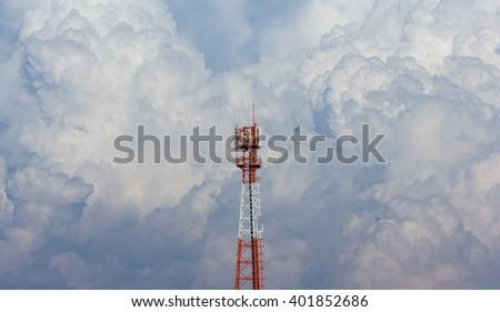 telecommunication tower on big cloud background - stock photo