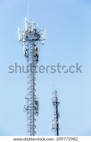 Telecommunication tower on blue sky.