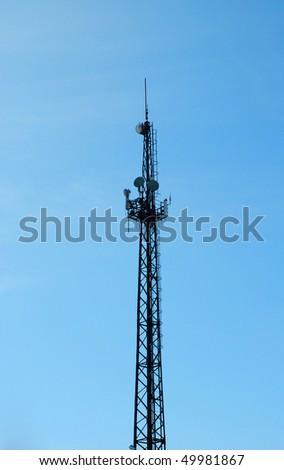 telecommunication tower over blue sky - stock photo