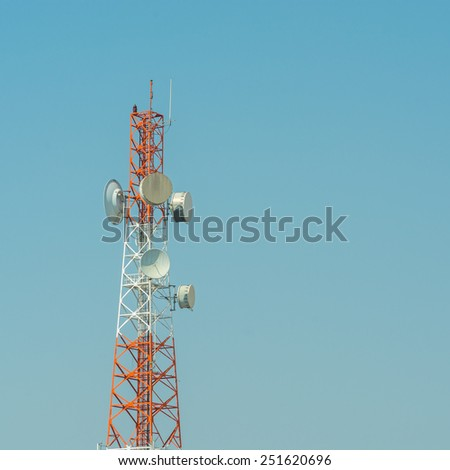 Telecommunication tower using to transmit television signals with a blue sky background - stock photo