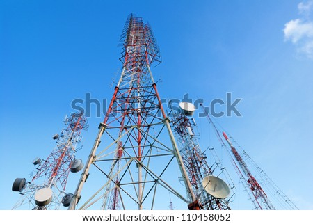Telecommunication tower with a  sunlight. Used to transmit television signals. - stock photo