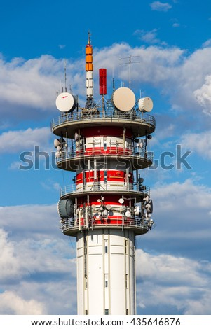 Telecommunication tower with antennas and blue sky
