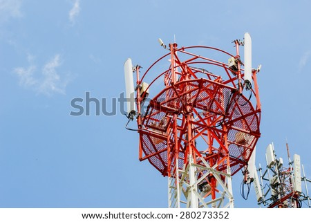 Telecommunication tower with antennas with blue sky - stock photo