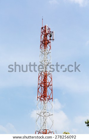Telecommunication tower with cloudy sky. - stock photo