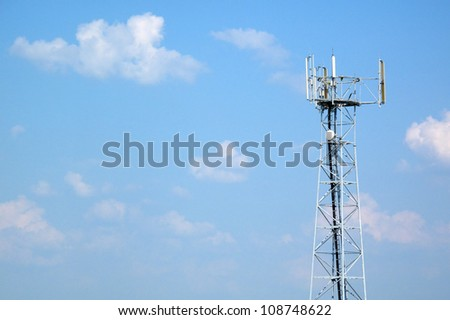Telecommunication tower with different antenna under blue sky. Technology concept. - stock photo