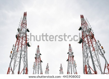 Telecommunication towers with TV antennas and satellite dish on clear sky