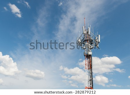 Telecommunications antenna for radio, television and telephone white cloud and Blue sky