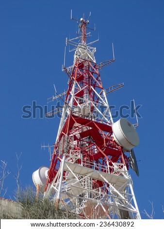 Telecommunications antenna for radio, television and telephony - stock photo