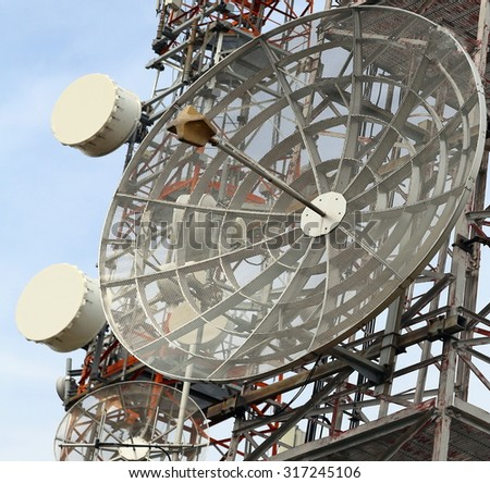 telecommunications antennas and repeaters of television and telephone signals - stock photo