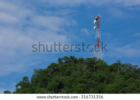 Telecommunications tower. Large transmission tower against sky broadcasting towers In mountains  Communication tower  - stock photo