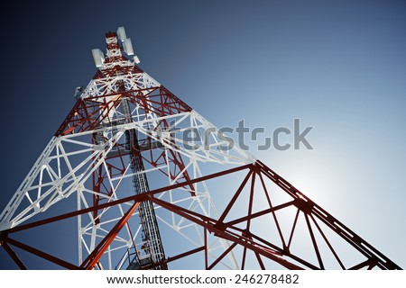 Telecommunications tower with clear blue sky. - stock photo