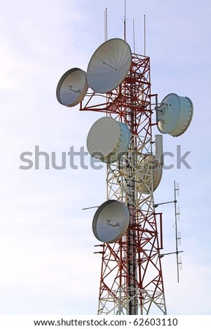 telecommunications tower with many satellite dish