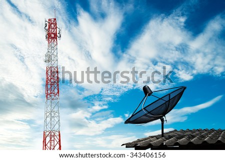 telecommunications tower with satellite dish on roof - stock photo