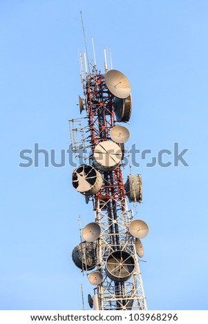 Telecommunications tower with several kind of antennas - stock photo