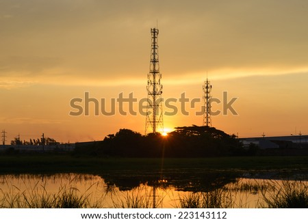 telecommunications tower with sunrise, silhouette - stock photo