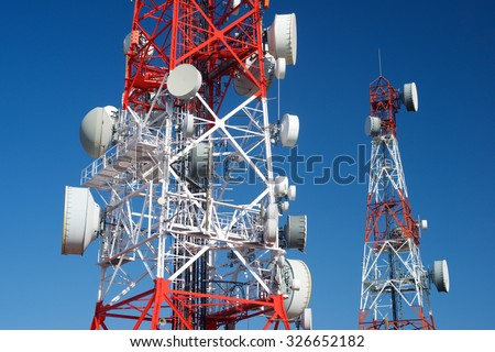 Telecommunications towers with clear blue sky. - stock photo