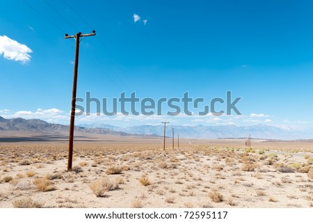 Telegraph poles in Death Valley - stock photo