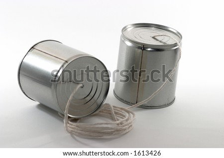 Telehones made out of tin cans and a string - stock photo
