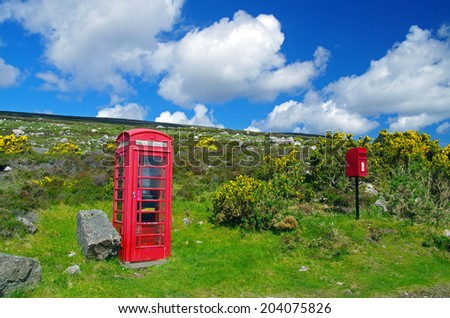 Telephone and letterbox in the mid of no where - stock photo