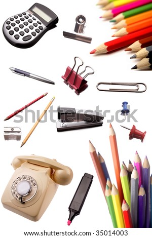 Telephone, calculator, pencils and various other stationery isolated on white background - stock photo