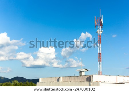 Telephone mast on Blue sky with big clouds and  free space for your text - stock photo