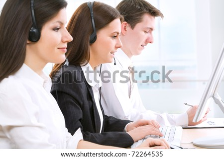 Telephone operators working in an office - stock photo