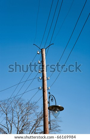 telephone pole with street lighting