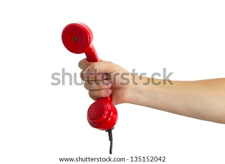 Telephone receiver in hand - stock photo